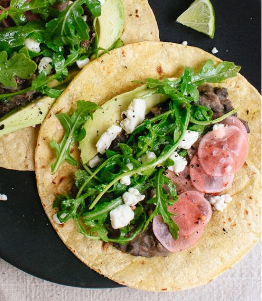 Fresh Arugala and Black Bean Tacos with Pickled Radish and Feta from Cookie + Kate